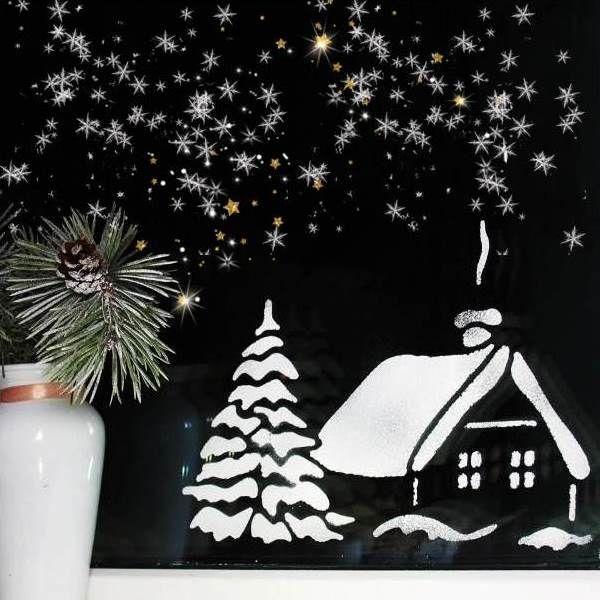 заснеженный домик новогодний рисунок сделанный мукой на окне фото
